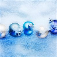 Blue and apricot-coloured Christmas baubles hidden in the snow Stock Photo - Premium Royalty-Freenull, Code: 659-07598318