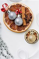 Dried fruit, cinnamon sticks, star anise and Christmas tree baubles Stock Photo - Premium Royalty-Freenull, Code: 659-07598362