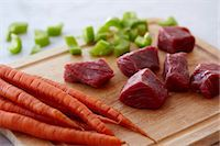 Chunks of Raw Beef, Raw Carrots and Chopped Celery on a Wooden Cutting Board Stock Photo - Premium Royalty-Freenull, Code: 659-07598521