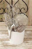 Assorted kitchen utensils in a ceramic pot Stock Photo - Premium Royalty-Freenull, Code: 659-07598587