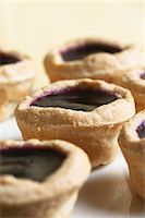 Several blueberry tarts Stock Photo - Premium Royalty-Freenull, Code: 659-07598644