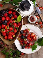 strawberries - Strawberries and blackberries with a set of kitchen scales Stock Photo - Premium Royalty-Freenull, Code: 659-07598829