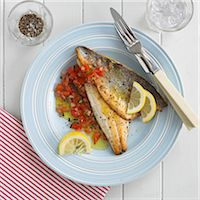 Fillets of sea bass with tomato salsa Stock Photo - Premium Royalty-Freenull, Code: 659-07599286