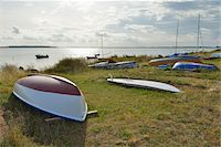 sailboat  ocean - Boats docked on beach, Summer, Vitte, Baltic Island of Hiddensee, Baltic Sea, Western Pomerania, Germany Stock Photo - Premium Royalty-Freenull, Code: 600-07599924