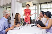 Business colleagues around dining table in restaurant Stock Photo - Premium Royalty-Freenull, Code: 6109-07600906