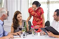 Business colleagues around dining table in restaurant Stock Photo - Premium Royalty-Freenull, Code: 6109-07600908