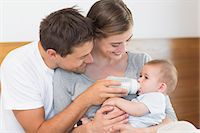 Happy parents with their cute baby son Stock Photo - Premium Royalty-Freenull, Code: 6109-07601255