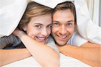 flat - Happy couple under the duvet Stock Photo - Premium Royalty-Freenull, Code: 6109-07601267