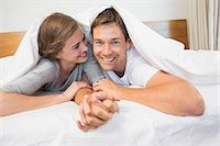 Happy couple under the duvet Stock Photo - Premium Royalty-Freenull, Code: 6109-07601270