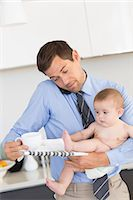 person overwhelmed stresss - Busy father holding his baby son before work Stock Photo - Premium Royalty-Freenull, Code: 6109-07601347