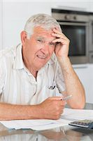 flat - Worried senior man paying his bills Stock Photo - Premium Royalty-Freenull, Code: 6109-07601417