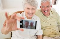 Senior woman taking a selfie with her smartphone Stock Photo - Premium Royalty-Freenull, Code: 6109-07601473