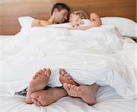 Full length of loving young couple in bed Stock Photo - Premium Royalty-Freenull, Code: 6109-07601539