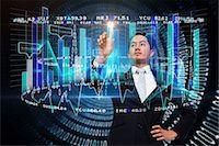 futuristic - Asian businessman pointing to data interface Stock Photo - Premium Royalty-Freenull, Code: 6109-07601576