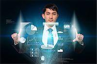 futuristic - Serious businessman touching interface Stock Photo - Premium Royalty-Freenull, Code: 6109-07601592