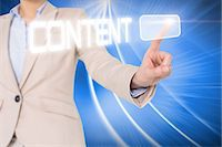 Businesswomans finger touching content button Stock Photo - Premium Royalty-Freenull, Code: 6109-07601717