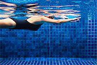Woman swimming in swimming pool, Thailand Stock Photo - Premium Royalty-Freenull, Code: 6102-07602792