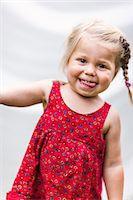 Portrait of smiling girl, Sweden Stock Photo - Premium Royalty-Freenull, Code: 6102-07602796
