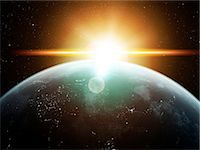 Earth and Sun, computer artwork. Stock Photo - Premium Royalty-Freenull, Code: 679-07603180