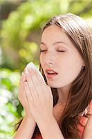 people coughing or sneezing - Young woman sneezing. Stock Photo - Premium Royalty-Freenull, Code: 679-07607575