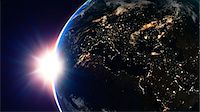 Artwork of a sun over planet earth. Stock Photo - Premium Royalty-Freenull, Code: 679-07607960