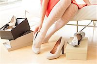 Woman trying on a pair of new shoes. Stock Photo - Premium Royalty-Freenull, Code: 679-07608000