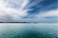 sailboat  ocean - Seascape with sailboats in the distance. Stock Photo - Premium Royalty-Freenull, Code: 679-07608238
