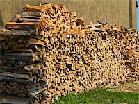 Stack of firewood next to building, Germany Stock Photo - Premium Royalty-Freenull, Code: 600-07608341