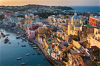 Overview of harbour at sunset, Corricella, Procida, Gulf of Naples, Campania, Italy. Stock Photo - Premium Rights-Managednull, Code: 700-07608362
