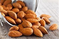 release - Whole almonds falling out of a metal bucket Stock Photo - Premium Royalty-Freenull, Code: 659-07610034