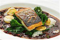 Sea bass in olive gravy Stock Photo - Premium Royalty-Freenull, Code: 659-07610347
