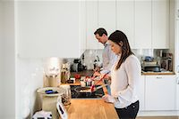 Couple preparing food together in kitchen Stock Photo - Premium Royalty-Freenull, Code: 698-07611633