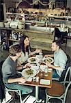 Happy friends communicating in restaurant