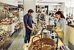 Salespeople working in supermarket
