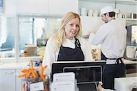 small business owners - Portrait of confident female owner standing at checkout counter in cafe Stock Photo - Premium Royalty-Freenull, Code: 698-07611974