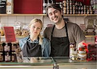 small business owners - Portrait of smiling worker standing in supermarket Stock Photo - Premium Royalty-Freenull, Code: 698-07611999