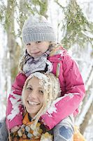 Mother carrying daughter on shoulders, portrait Stock Photo - Premium Royalty-Freenull, Code: 618-07612091