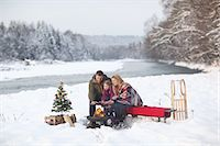 snow christmas tree white - Family sitting at campfire in snow Stock Photo - Premium Royalty-Freenull, Code: 618-07612098