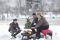 Family sitting at campfire in snow Stock Photo - Premium Royalty-Freenull, Code: 618-07612099