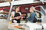 Saleswomen conversing in supermarket