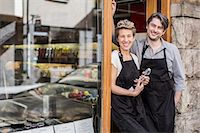 small business owners - Portrait of confident workers standing at supermarket entrance Stock Photo - Premium Royalty-Freenull, Code: 698-07612004