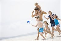 Family running together on beach Stock Photo - Premium Royalty-Freenull, Code: 618-07612138