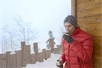 Man enjoying hot drink from flask Stock Photo - Premium Royalty-Freenull, Code: 618-07612276