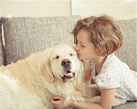dog kissing girl - Young girl kissing pet dog Stock Photo - Premium Royalty-Freenull, Code: 618-07612342