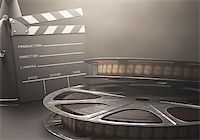 Clapperboard with rolls of film in the retro concept cinema. Stock Photo - Royalty-Freenull, Code: 400-07621006