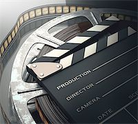 Clapperboard with rolls of film in the retro concept cinema. Stock Photo - Royalty-Freenull, Code: 400-07621007