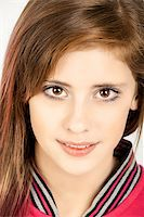 Studio fashion portrait of young beautiful girl with nice eyes on white background Stock Photo - Royalty-Freenull, Code: 400-07621048