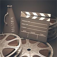 Clapperboard with rolls of film in the retro concept cinema. Stock Photo - Royalty-Freenull, Code: 400-07624394