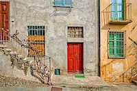 Facade of typical italian house with colorful windows and doors in town of Saluzzo in Piedmont, Northern Italy. Stock Photo - Royalty-Freenull, Code: 400-07625148