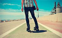 roller skate - a young man roller skating, with a cross-processed effect Stock Photo - Royalty-Freenull, Code: 400-07628015